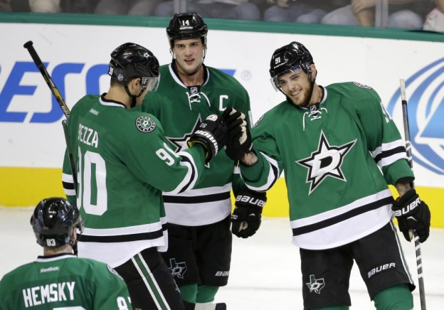Dallas Stars' Ales Hemsky (83) of Czech Republic, Jason Spezza (90) and Jamie Benn (14) congratulate Tyler Seguin (91) on his goal in the third period of a preseason NHL hockey game against the Florida Panthers, Monday, Sept. 29, 2014, in Dallas. Seguin scored three goals and the Stars rallied to beat the Panthers 5-4. (AP Photo/Tony Gutierrez) 10022014xSPORTS